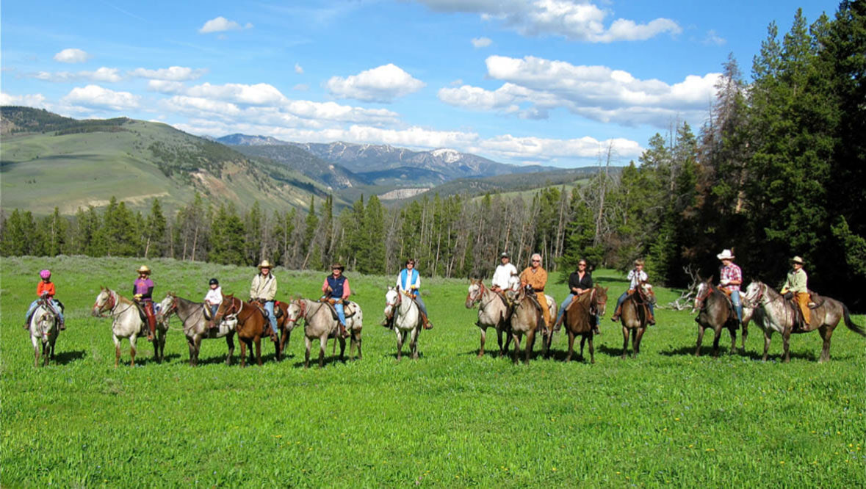 Family trail ride at Nine Quarter Circle Ranch