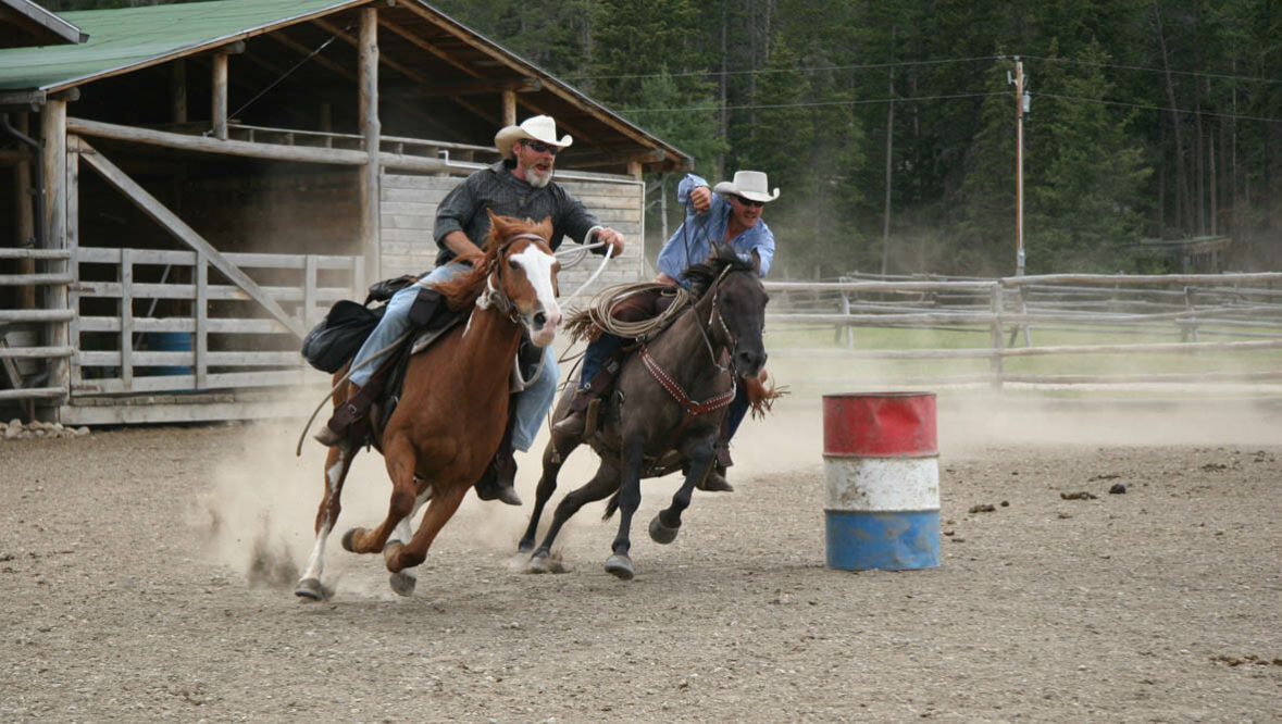 Two riders in a rodeo race at Paradise Guest Ranch