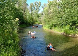 R Lazy S Ranch kids tubing down creek
