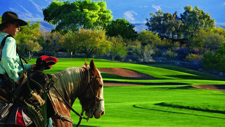 Man on horse on golf course at Rancho de los Caballeros