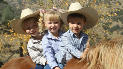 Three young kids on a horse at Rankin Ranch