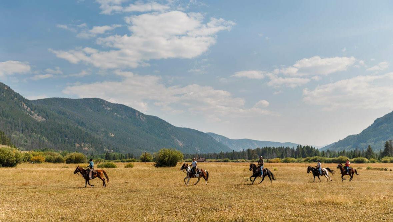 Trail ride galloping at Rawah Ranch
