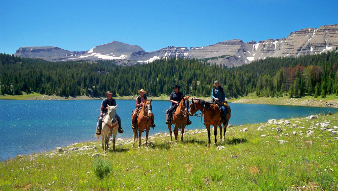 Family trail ride by a lake at Red Rock Lodge