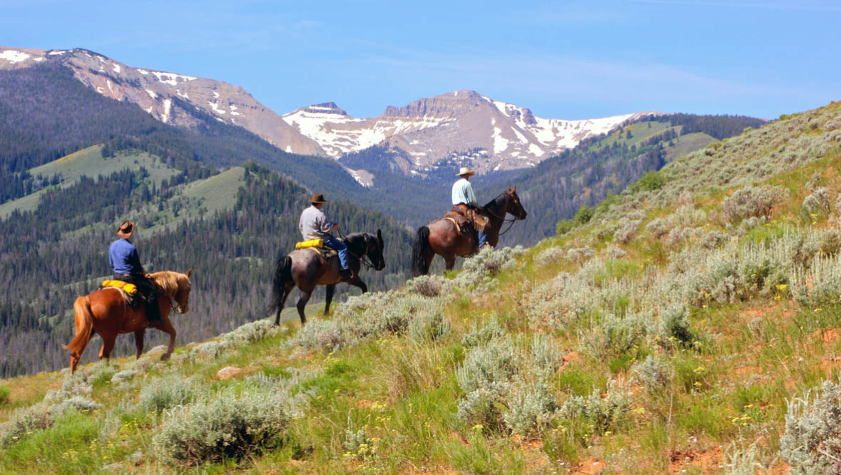 Three riders on a trail at Red Rock Ranch