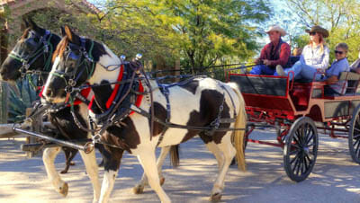 People in a horse drawn wagon at Stagecoach Trails Guest Ranch