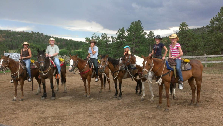 Sundance Trail Ranch family on horses