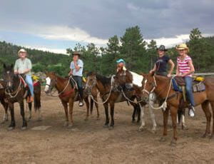Sundance Trail Ranch family on horses