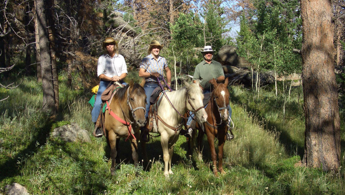 Sundance Trail Ranch three guests on horses