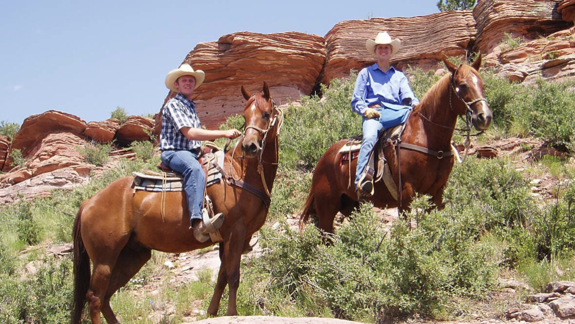 Sylvan Dale Ranch two riders on horses