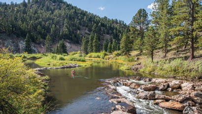 Fly fishing in a river at The Broadmoor's Ranch