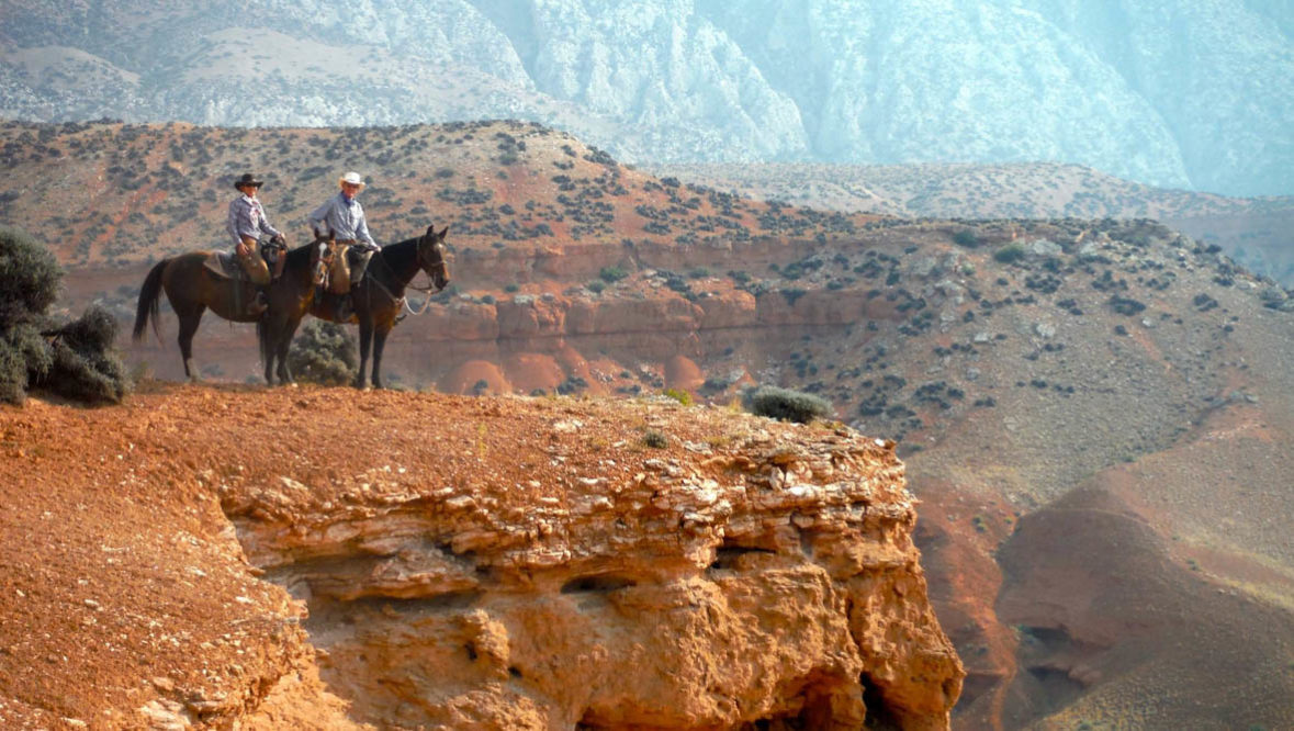 Riders on horses at Hideout Lodge Ranch