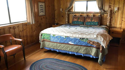 Cabin bedroom at Triangle X Ranch