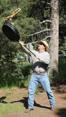 Man flipping a giant pancake in the air