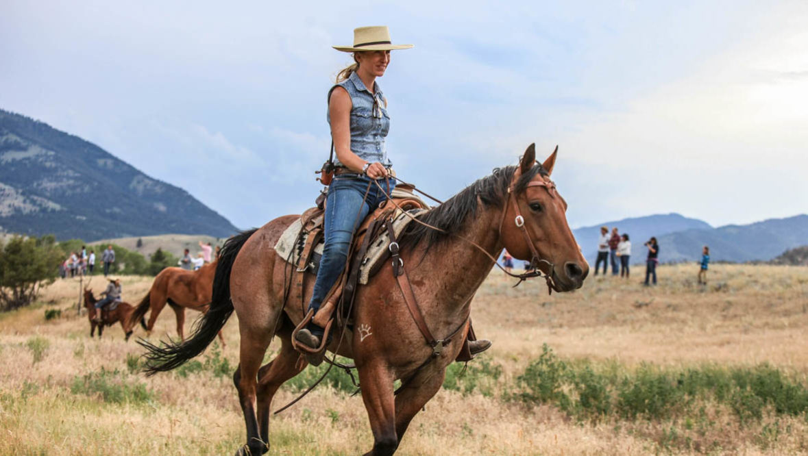 Cowgirl on a horse at Mountain Sky Guest Ranch