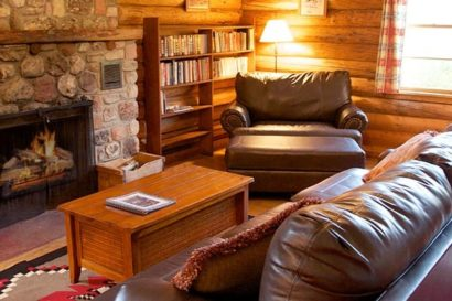couch and chair in log cabin