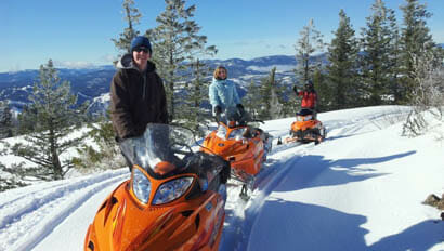 Family snowmobiling at K Diamond K Ranch