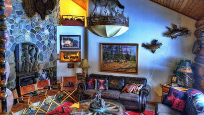 Lodge living room with fireplace at McGinnis Meadows Cattle Ranch