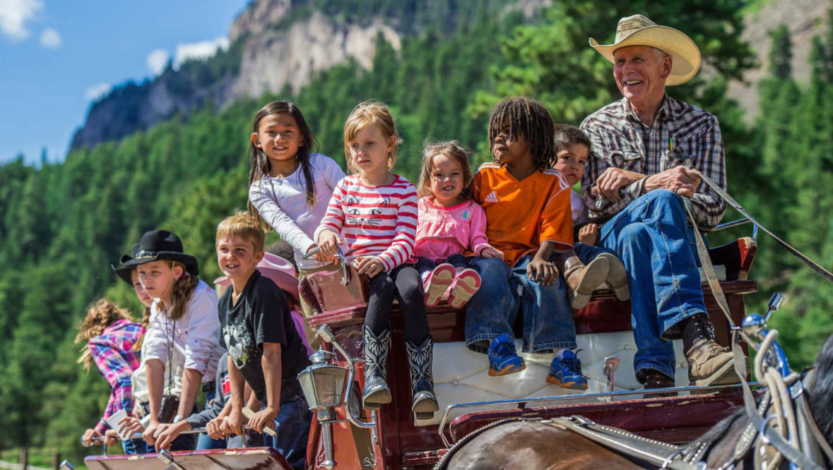 Wagon ride with kids at Rainbow Trout Ranch