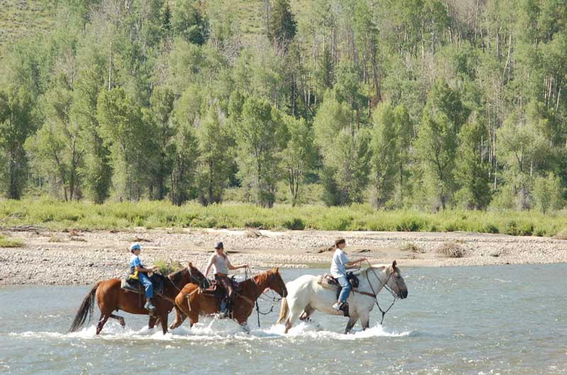 Goosewing-Ranch-Riding-the-River - Eco-tourism