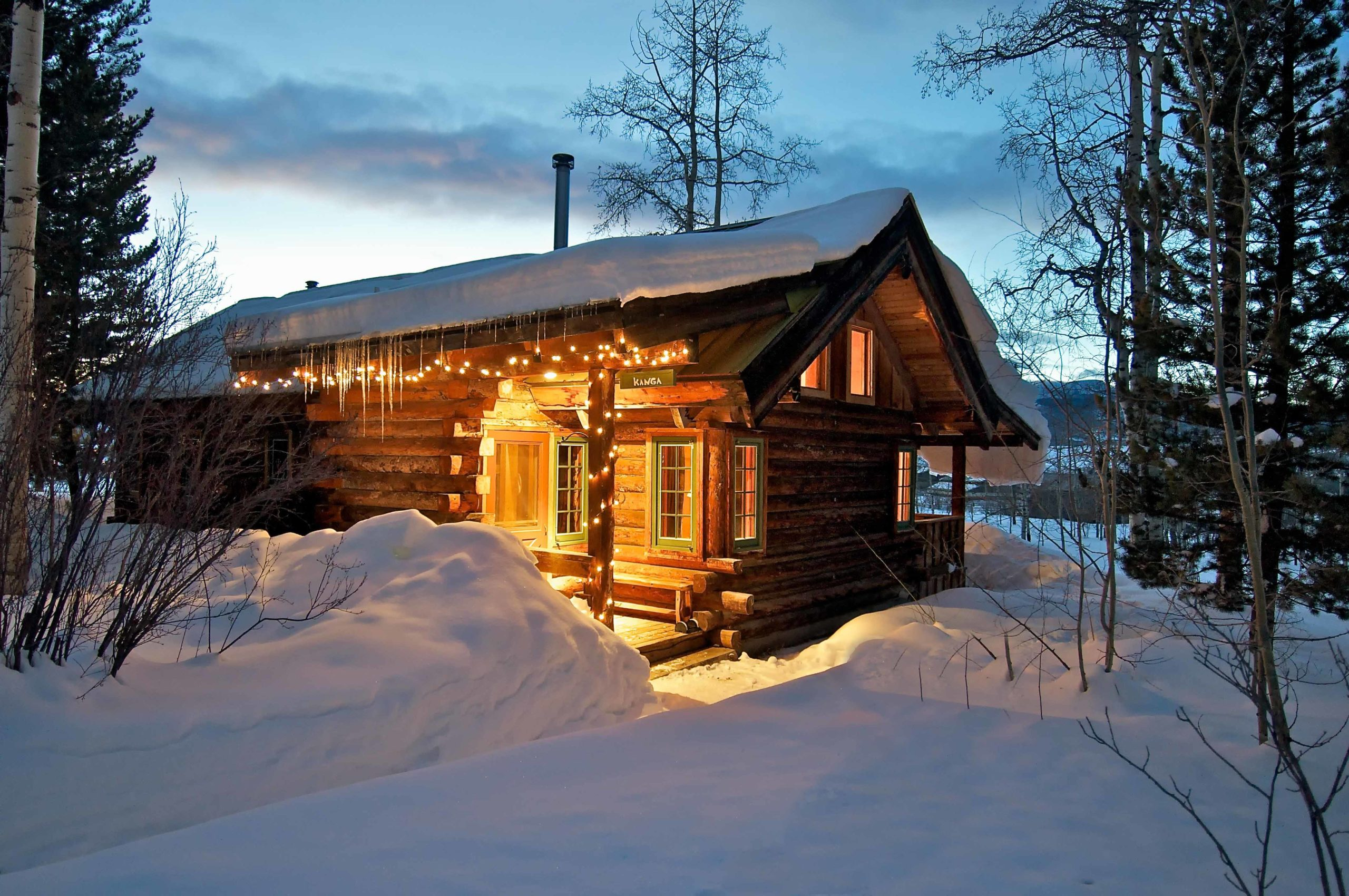 Stay at in a cabin at the Home Ranch during the winter.