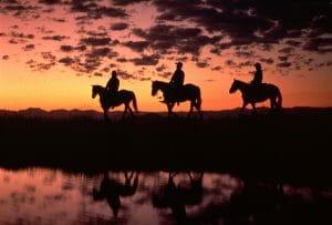 Latigo-Riders-silhouette-sunset