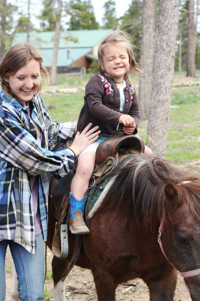 Wind River Ranch Baby Riding a Pony