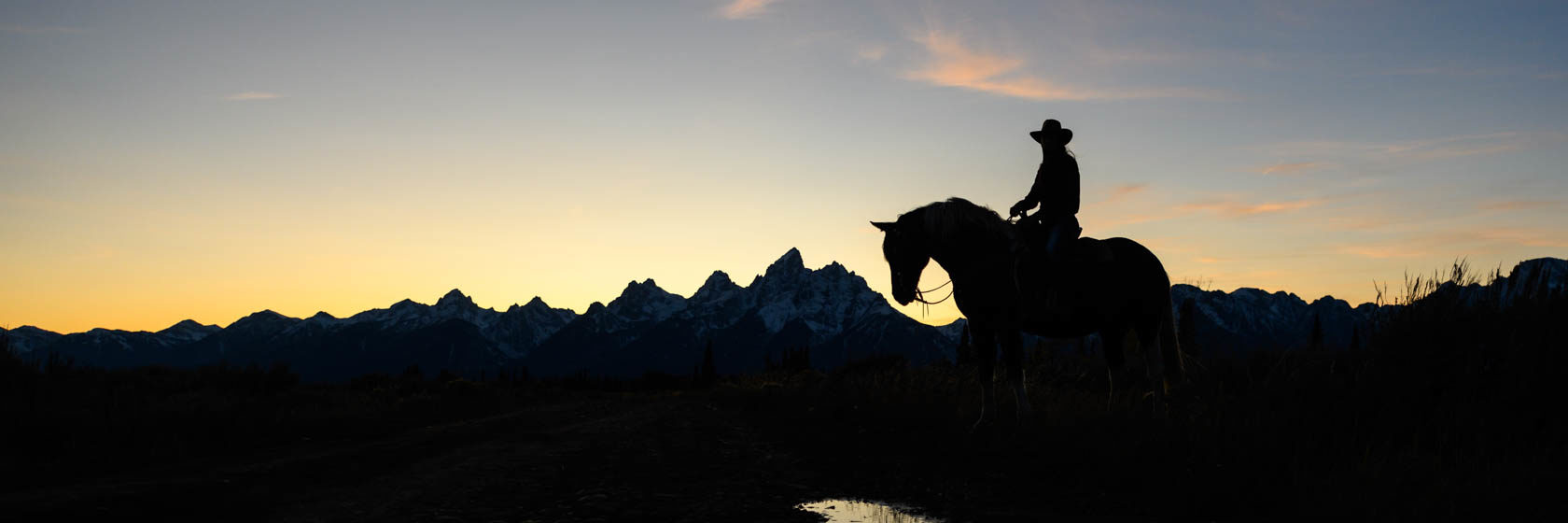 Rider in silhouette in Wyoming