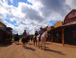 Tombstone Monument Ranch horses riding down street at ranch