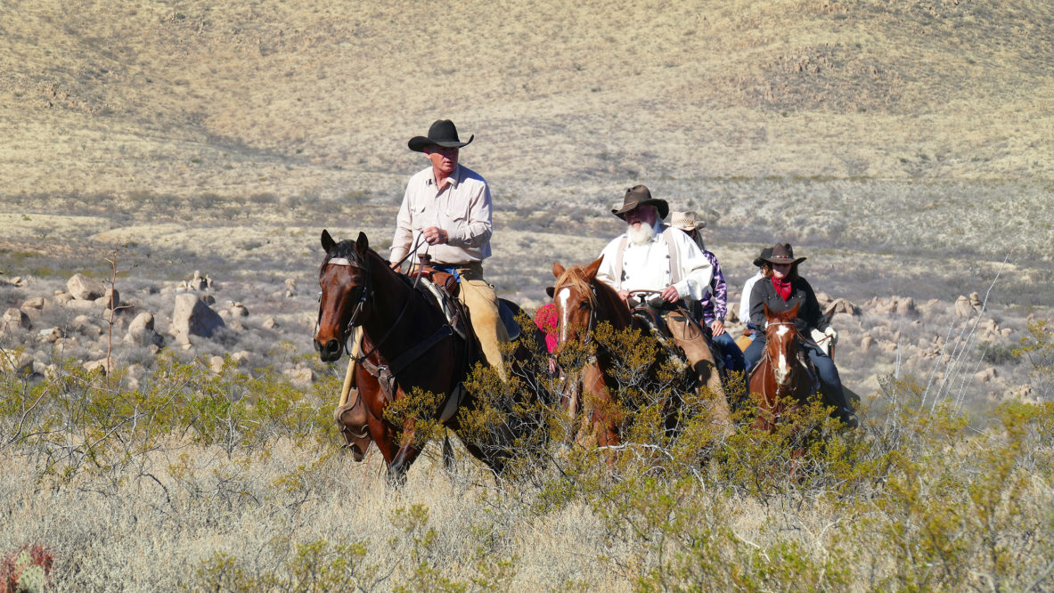 Tombstone Monument Ranch riders in the desert